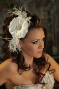 SF101-Chic silk flower with Swarovski crystal broach in center accented by few feathers